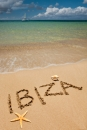 Ibiza written in sand on beach